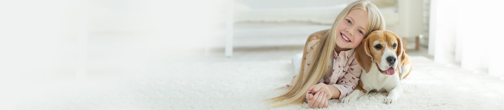 girl-and-dog-on-carpet